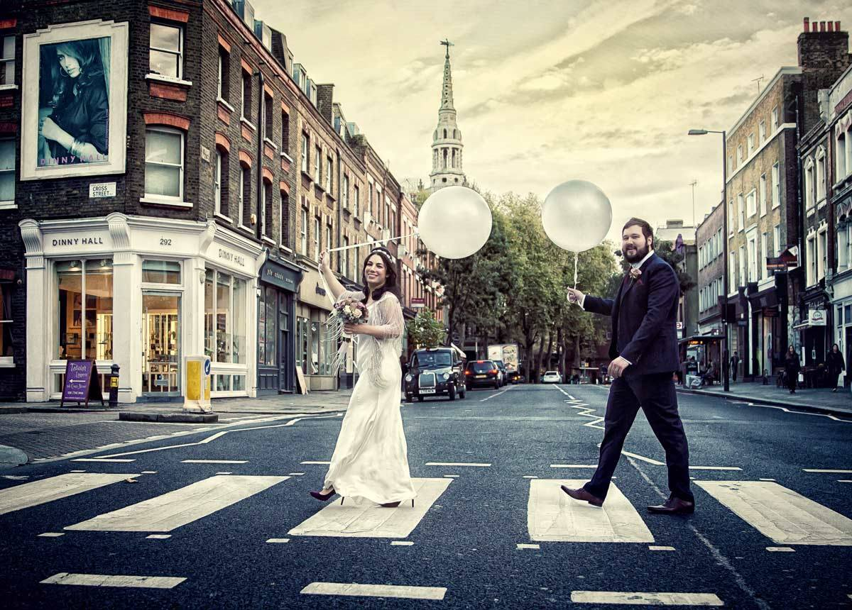 Couple With Balloons On Upper Street Crossing At Islington Town Hall Wedding